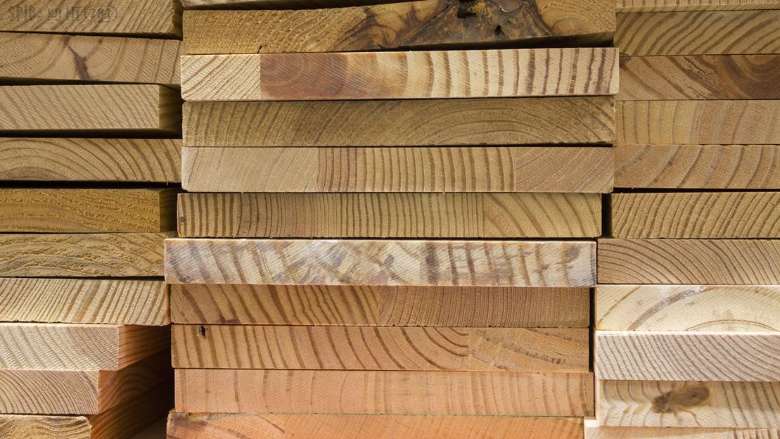 A large pile of timber planks