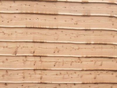 Wooden cladding fitted on a wall